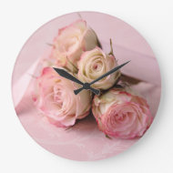 pale roses on pink swirls clock