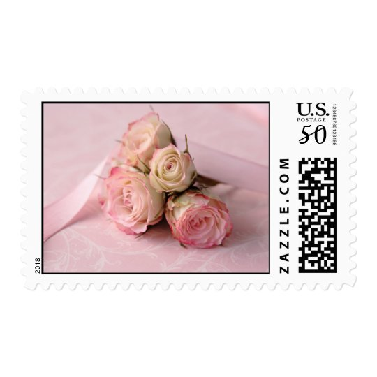 pale roses on pink swirls postage