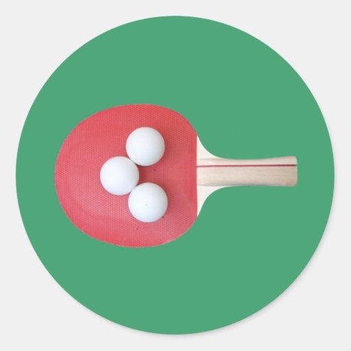 Paleta y bolas del ping-pong pegatina redonda