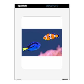 Palette surgeonfish and clown fish swimming iPad skins