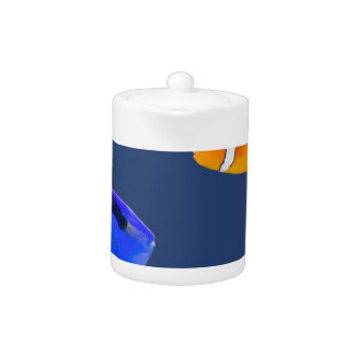 Palette surgeonfish and clown fish swimming teapot
