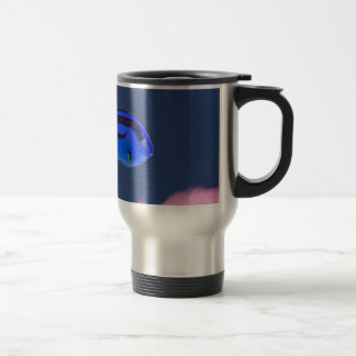 Palette surgeonfish swimming in blue water travel mug