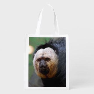Palidezca el mono hecho frente de Saki Bolsas De La Compra