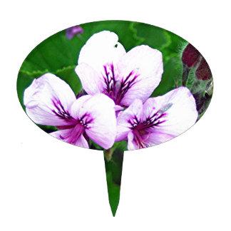 Palidezca - las flores rosadas y púrpuras del figura para tarta