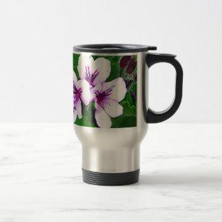 Palidezca - las flores rosadas y púrpuras del taza de viaje de acero inoxidable