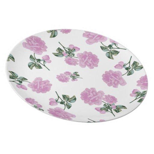 Palidezca - rosas rosados - la placa blanca del es plato para fiesta
