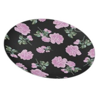 Palidezca - rosas rosados - la placa negra del est platos