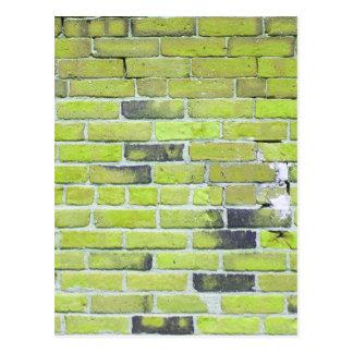 Pálido - textura verde de la pared de ladrillo del postal