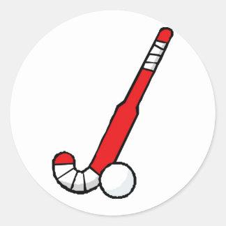 Palillo de hockey hierba rojo etiquetas redondas