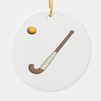 Palillo y bola de hockey hierba adorno navideño redondo de cerámica