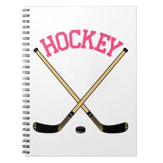 Palillos cruzados del hockey libros de apuntes con espiral