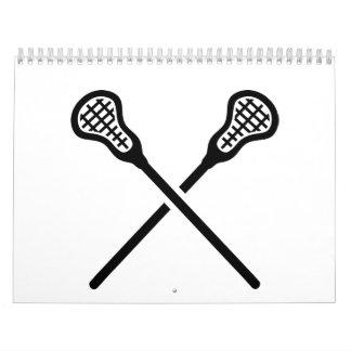 Palillos cruzados del lacrosse calendario