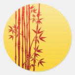 Palillos de bambú rojos con las hojas en amarillo pegatina