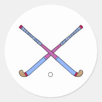 Palillos de hockey hierba etiqueta redonda
