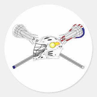 Palillos de LaCrosse con el casco Etiqueta Redonda