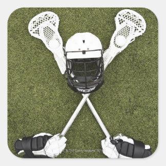 Palillos de LaCrosse, guantes, bolas y casco de Pegatina Cuadrada