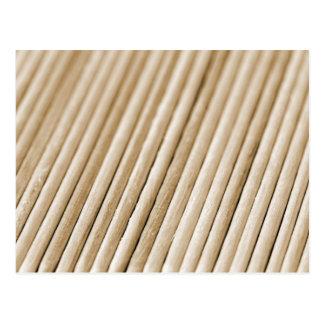 Palillos de madera (tono del sephia) tarjeta postal