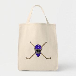 Palillos del casco y de la cruz del hockey azules bolsas de mano