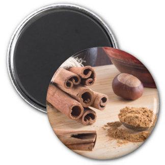 Palillos y polvo de canela imanes