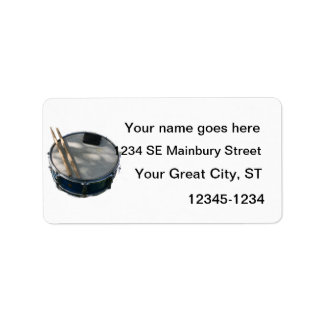 Palillos y silenciador azules del tambor etiquetas de dirección