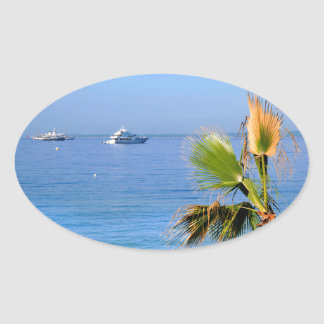 Palm tree and mediterranean sea in France Oval Sticker