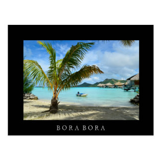 Palm tree and overwater resort black postcard