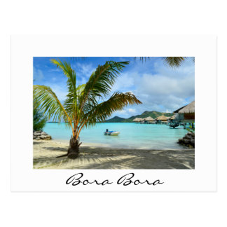 Palm tree and overwater resort white postcard