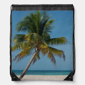 Palm tree and white sand beach  2 drawstring bag