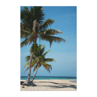 Palm tree and white sand beach canvas print