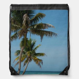 Palm tree and white sand beach drawstring bag