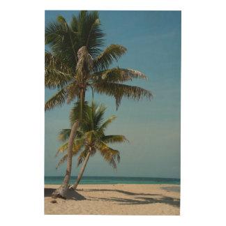 Palm tree and white sand beach wood print