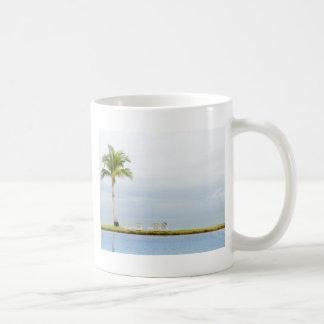 Palm tree by a swimming pool classic white coffee mug