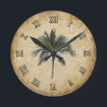 """Palm Tree Round Clock<br><div class=""""desc"""">This design will match any tropical interior. More products with this design available.</div>"""