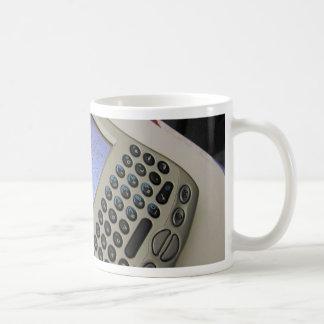 Palmas de los teléfonos móviles de los PDA de la P Taza De Café