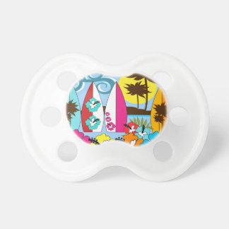 Palmera de las tablas hawaianas de la playa del chupetes para bebes