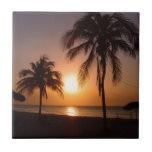 Palmeras en la puesta del sol azulejo cerámica
