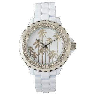Palmeras tropicales del oro atractivo en blanco reloj