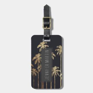 Palmeras tropicales del oro atractivo en negro etiqueta de maleta