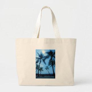 Palmeras y cielos azules bolsas