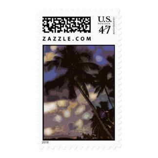 Palmeras y franqueo azul de la puesta del sol sellos postales