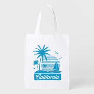 Palmeras y velero de California Bolsa De La Compra