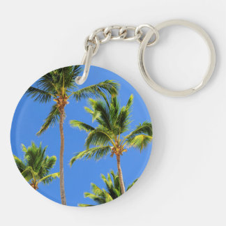 Palms on blue sky background keychain