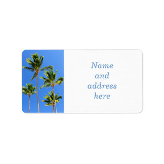 Palms on blue sky background label