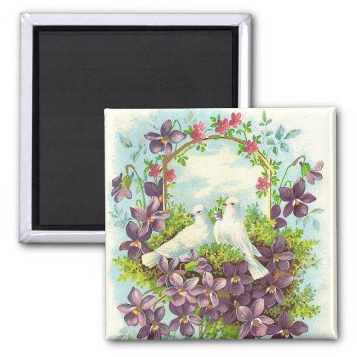 Palomas y flores imán de frigorifico