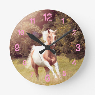 Palomino Paint horse gallops over a meadow Round Clock