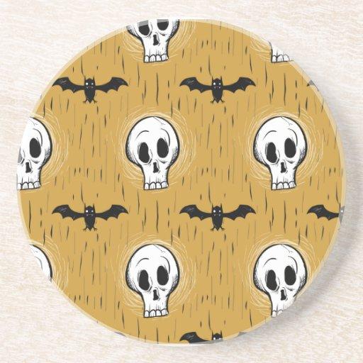 Palos y cráneos posavasos diseño