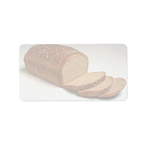 Pan cortado delicioso del trigo etiquetas de dirección
