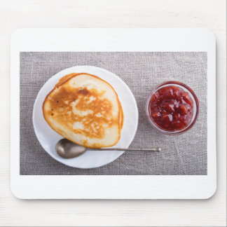Pancakes and a glass cup with strawberry jam mouse pad
