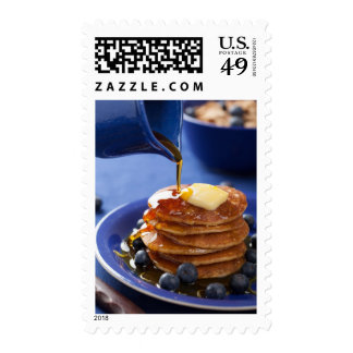 Pancakes with syrup and blueberry postage stamps