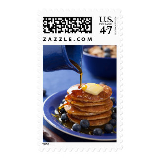 Pancakes with syrup and blueberry postage stamp